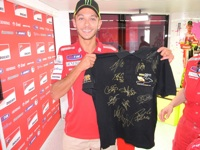 Valentino Rossi is one of 20 signatures on one of our shirts we donated to Riders for Health, fetching 2000!