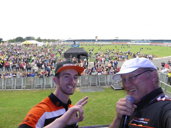 [ID: 14701] John McPhee joins Gordon on stage at Riders for Health auction Saturday(credit: Pole Position Travel)