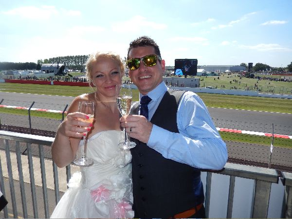 Wedding couple Richard and Annabelle toast on the balcony of our Brooklands suite
