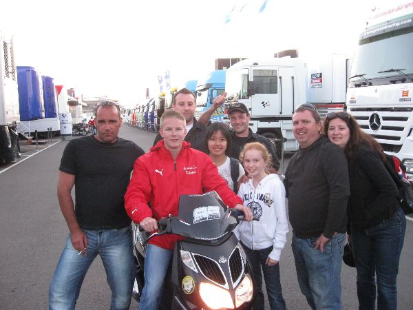 Danny Webb with Team Experience customers in paddock